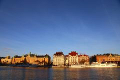 Old ships on the winter embankment of Stockholm. sunny Stockholm. Sweden royalty free stock photo
