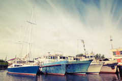 Old ships and yachts are moored. Vintage toned photo Royalty Free Stock Image