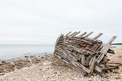 Old shipwreck on a beach Royalty Free Stock Photography