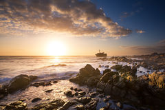 Old shipwreck long exposure on the rocks sunse Royalty Free Stock Photo