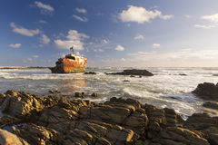 Old shipwreck long exposure on the rocks sunset Royalty Free Stock Photography