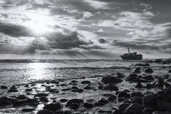 Old shipwreck long exposure on the rocks sunset artistic convers Stock Images