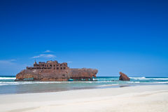 Old shipwreck on sandy beach Royalty Free Stock Photography