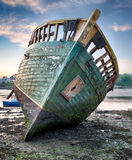 Old Shipwreck. An old wrecked wooden boat on the shore stock photography