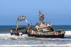 Old shipwreck Zeila at the Atlantic Coast between Swakopmund and Henties Bay along the famous Skeleton Coast in Namibia, Africa. stock photos
