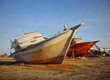 Old shipwrecks Boats Sailing Transport Seaside Stock Photo