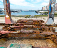 Old shipyard ramp disused. Detail of the old and rusty machinery a disused shipyard ramp Royalty Free Stock Images
