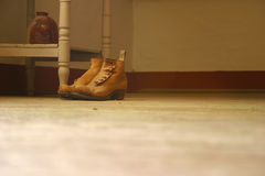Old shoe. On a wood floor Stock Image