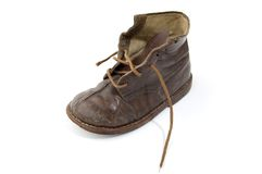 Old shoe. Isolated old handmade leather shoe Royalty Free Stock Photos