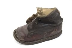 Old shoe. Isolated old handmade leather shoe Royalty Free Stock Photo