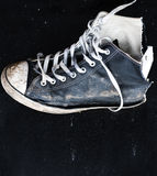 Old shoe on black board. Old shoe nailed to a black board Stock Images