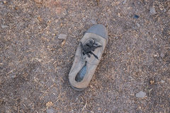 Old shoe on the ground Royalty Free Stock Photography