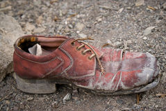 Old shoe left on a track Royalty Free Stock Images