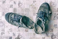 Old shoe of student. On ground Royalty Free Stock Images