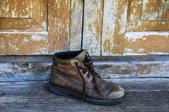 Old shoe on the vintage background Royalty Free Stock Image