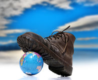 Old shoe from work. That crushes the globe Royalty Free Stock Photo