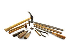 Old shoemaker tools. Old shoemaker or carpenter tools isolated on a white background stock photo