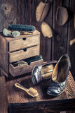 Old shoemaker workplace with tools, shoes and laces Royalty Free Stock Photos