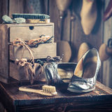 Old shoemaker workshop with shoes, laces and tools Royalty Free Stock Photography