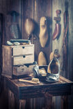 Old shoemaker workshop with tools, leather and shoes Royalty Free Stock Photo