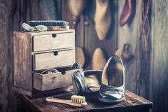Old shoemaker workshop with tools, shoes and leather Royalty Free Stock Images