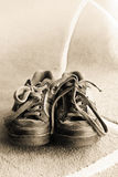 Old shoes. Beautiful old sport shoes of a little boy Royalty Free Stock Photo