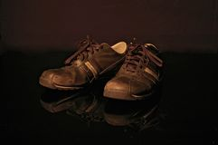 Old Shoes. A vintage looking pair of shoes royalty free stock photos