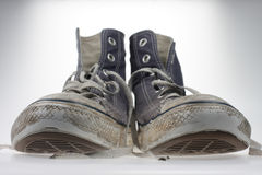 Old Shoes. A pair of old and battered canvas shoes Stock Images