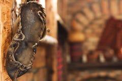 Old shoes. Decoration of old village shoes. Village tourism elements Stock Photo