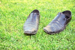 Old shoes. On the grass Royalty Free Stock Photos