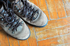 Old Shoes. A pair of old leather shoes on old wooden floor Royalty Free Stock Images