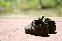 Old shoes. On a wooden floor Stock Photos