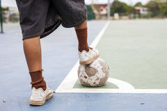 Old shoes and ball a lack . Royalty Free Stock Photo