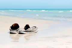 Old shoes on  beach Royalty Free Stock Photo