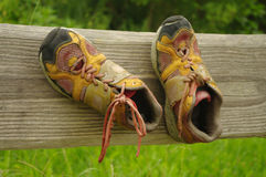 Old shoes on a board. In nature Royalty Free Stock Image