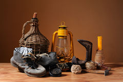 Old shoes, candle wax and tools Royalty Free Stock Photos