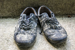 Old shoes on concrete Stock Image