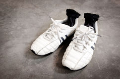 Old shoes on concrete floor Royalty Free Stock Photography