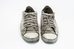 Old shoes. Dirty sneakers isolated on a white background Royalty Free Stock Photo