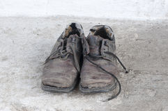 Old shoes on floor Stock Images