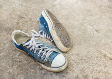 Old shoes on the floor Royalty Free Stock Images