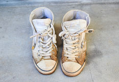 Old shoes on the floor Stock Photography