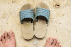 Old shoes and foot Royalty Free Stock Photos