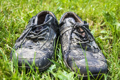 Old shoes in the grass Royalty Free Stock Photos