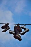 Old shoes hanging on a wire Royalty Free Stock Photo