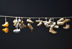 Old shoes hanging on a wire Royalty Free Stock Photos