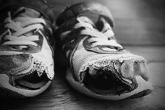 Old shoes with holes shoelaces worn shabby homeless clothing Royalty Free Stock Images