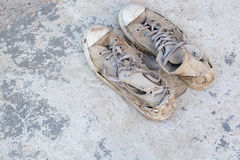 Old shoes left on the floor of the house screaming cracking. Stock Photography
