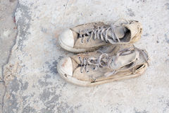 Old shoes left on the floor of the house screaming cracking. Stock Images