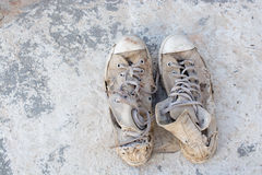 Old shoes left on the floor of the house screaming cracking. Royalty Free Stock Image